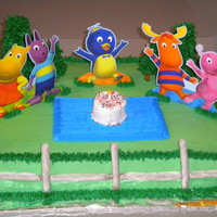 Backyardigans  Backyardigans sheet cake on short notice, but thought it turned out okay. WASC with buttercream. Fence are white chocolate dipped pretzel...