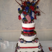 Red, White, And Blue Political Campaign Cake   WASC and Red Velvet tiers all in buttercream. Accented with red, white, and blue dipped strawberries.