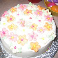 Marshmallow Flower Cake I just cut up miniature marshmallows to assemble these flowers. Keep a small bowl of water nearby to clean your scissors, as they will get...