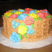 Cascading Rose Basket Cake  I had no problem with creating the basket weave on my cake. However, I learned the importance of making my roses in advance! I had a tough...