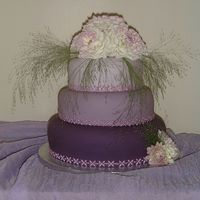 Lilac & Purple Wedding Cake This was made to match the theme of the wedding. The bride wanted fresh flowers on the top of her cake to match her bouquet.