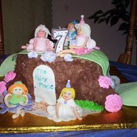 Alison's Fairy Tree Stump Cake This is my most recent cake. It was done in October of 2006. It's the first time I ever made fondant fairies. Thanks to Liis...