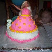 Emily's Barbie Cake This is the 2nd cake I had ever made. It was done in June of 2005. At this time I learned a little about icing consistency, even used tips...