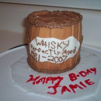 Jamie's Whiskey Barrel Cake I made this cake out of cake scraps that I had after making a puppy cake. So I just threw some stuff together trying to make it resemble...