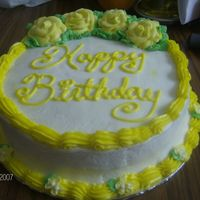 Yellow And White B-Day Cake  this cake wasen't difficult at all regular yellow cake with almond flavored simple syrup to wet it the only thing that got me was i...