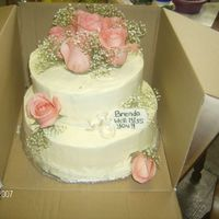 Going Away Flower Cake  Stacked cake 8 and 10 inch with never ever again cream cheese icing, very tasty but impossible to smooth. Yellow cake moistened with lemon...