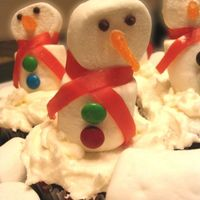 Snowman Cupcakes These were made for my daughter's class party. She watched way too much Food Network (She's 7!!) and saw Sandra Lee make these...