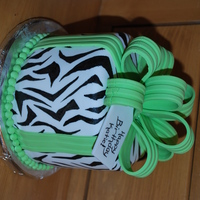 "Lil' Zebra Birtday Cake  This cake is 6"" round cake covered in fondant with fondant/gumpaste bow and gumpaste tag. The zebra stripes were painted on by hand,..."