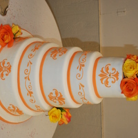 Orange Nottnagel Wedding Cake  I made this cake for my friends wedding. It was my first 5 tier cake, I was so nervous! And it was also my first time stenciling with royal...