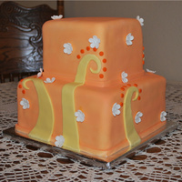 "Orange Bridal Shower Cake  This cake was made for a girl for her bridal shower. Her colors were orange and yellow. It's 6"" and 9"" square cakes covered..."