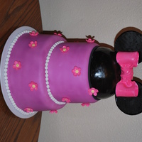 "Minnie Mouse Birthday Cake  This cake was made for a little girl's birthday and the theme was minnie mouse. It's 6"" and 8"" round cake covered in..."