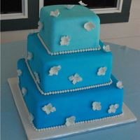"Blue Hydreanga Wedding Cake  This is a 6"", 9"" & 12"" square cake. I airbrushed the cake different shades of blue and added gumpaste white hydreangas...."