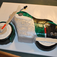 "Harley Motorcycle Cake  This cake was made to look like the person's actual motorcycle that he has. I used a half sheet size pan and some 8"" round pans..."