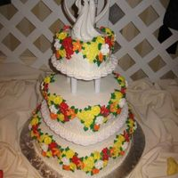 Fall Flowers This cake was Wilton inspired, just a change in color and some of the flowers. The flowers are royal icing. I loved the fall colors the...