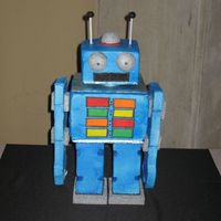 Robot This was for the groom at the rehersal dinner. It was my first 3-D cake so it took alot longer than the next one will.