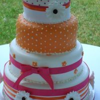 Tangerine This cake is originally from a clipping given to me years ago. The colors and flowers were changed for this bride. It was originally to be...