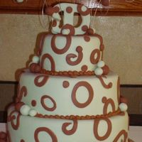 Trisha This cake was inspired by alot of cakes here. The colors were a light/sage green and chocolate brown. The topper is actually a wooden...