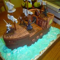 Pirates Cake This was a really fun cake to make. All fondant with a few gumpaste accents. The sails are gumpaste - the water is royal icing.