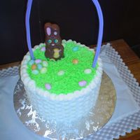 Easter Basket buttercream with jelly beans and a store bought bunny and plastic handle. The insides are chocolate and vanilla with a strawberry...