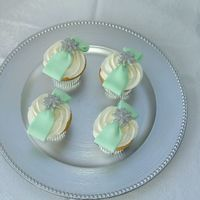 Sweet 16 Cupcakes These cupcakes were made for a Sweet 16. They were designed to match the birthday girl's gown that had a green sash and rhinestone...