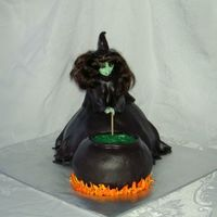 Halloween Witch At Cauldron Inspired by the awesome cake made by mommykicksbutt and posted to CC. This was so fun to make. Wondermold for witch, 2 small pyrex bowls...