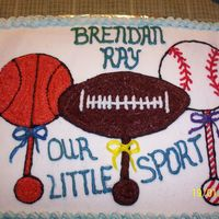 Rattles shower cake for sports family, all buttercream