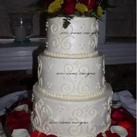 Love Scroll Yellow cake with IMBC and freehand scroll work. Her flowers were cool because they had little gold bead accents coming out of them, and the...