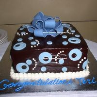 Baby Boy Present Chocolate cake, chocolate buttercream, chocolate ganache with a chocolate bow and fondant accents.