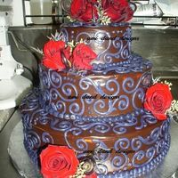 Chocolate And Purple chocolate cake with coconut and raspberry filling (I just make 'em folks :) )and chocolate ganache on top. Bride's colors were...