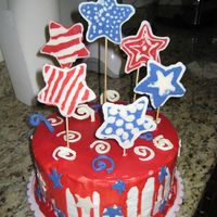 July 4Th frosted in BC, red pored chocolate ganache , stars are made of candy melts