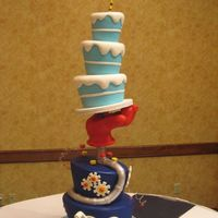 Dr. Seuss Wedding Cake Everything is cake... except for the glove which is styrofoam and modeling chocolate. There is a central threaded steel pipe and every tier...