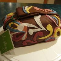 Vera Bradley Purse Cake A Vera Purse for my cousin's 24th birthday. Baked in a loaf pan & covered with chocolate MMF.