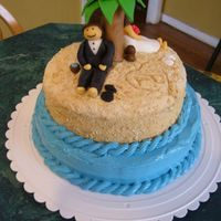 Beach Bridal Shower Cake Carrot cake with cream cheese frosting, sugar & graham cracker sand, fondant figures