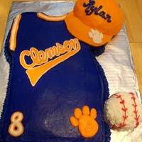 Clemson Tiger Jersey  Clemson tiger jersey w/ hat and baseball. Jersey is carved from 9x13 sheet. Ball is a cupcake rounded, and hat is 1/2 ball pan with fondant...