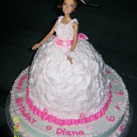 "Pink / Hot Pink / White Barbie Doll Birthday Cake Barbie Doll 6th Birthday Cake. Chocolate 14"" round base cake with white buttercream icing. Wilton doll cake pan and 2 10"" white..."