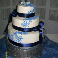 Ivory-Periwinkle Chocolate/white 3-Tier Wedding Cake Ivory color icing with periwinkle design after bride's wedding gown cascade down this white, chocolate 3 tier cake.