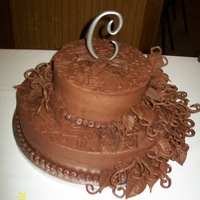 Chocolate Iced Orange Flavored Cheesecake Wedding Cake A 2nd wedding, cheesecake from Wilton wedding cake book and chocolate work / chocolate design from Wilton book. Wedding theme had a lot of...