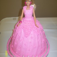 "Pink Barbie 4Th Birthday Cake Used a real Barbie doll wrapped in Saran Wrap from Waist down...(actual birthday present)...Pink Dress - used two 8"" round cakes (..."