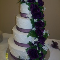 Round Wedding Cake - Dec 2009 All White Cake, Buttercream Frosting - ribbon and silk flowers Wedding colors were eggplant and dijon. ..quilted design on buttercream...