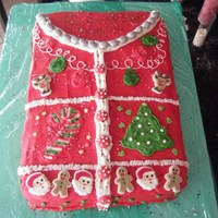 Ugly Christmas Sweater Cake Iced in buttercream, inside the cake was green and red vanilla swirl with whipped peppermint filling! Decorated with royal icing decor,...