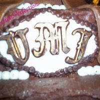 Close Up Of Monogram Made out of Chocolate and Fondant, Accented with Luster Dust