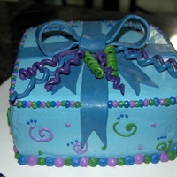 Present Stlye Cake   Vanilla cake w/ bavarian cream filling. Vanilla bc and fondant accents. For a little girl who loves blue. TFL