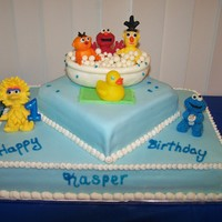 Sesame Street Bath 1st birthday cake for my son Kasper. It is from his favorite book Bubbles, Bubbles. Figures made from candy clay. Covered in fondant....