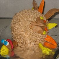 Turkey ball cake w/ buttercream and fondant head, legs, and feathers. I made this for our church auction at Thanksgiving!