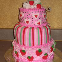 Strawberry Theme My take on the wilton s.s. cake. Fondant decorations and bow. Buttercream icing. chocolate/white cake. Made for niece's b-day.