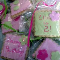 Ella's Cookies These cookies were for a little girl's 2nd birthday. The are NFSC decorated with fondant circles and flowers. A few of them were just...