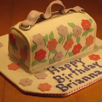Flower Purse This was done to look like the birthday girls favorite purse. I was happy with how it came out. Choco cake with fondant. Thanks for looking...