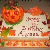 Pumpkin Birthday This was so much fun. I used the new wilton pan for the pumpkin. 11x15 sheet cake. All buttercream and fondant. The leaves were my favorite...
