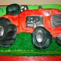 Tractor_Cake1.jpg  Tractor cake for a 3 year old's birthday. The tractor is made out of fondant. I used the Wilton Tractor pan as a mold and then I...