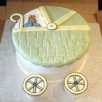 Baby Carriage Iced in buttercream and decorated with mmf and color flow.